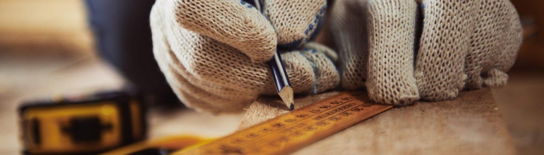 Carpenter measuring timber
